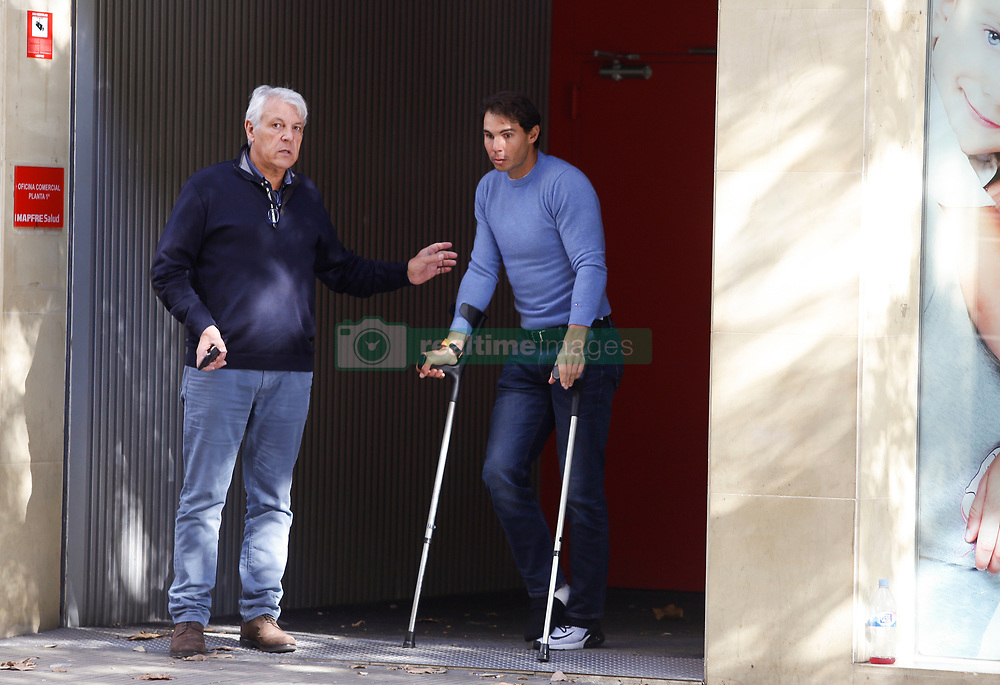 EXCLUSIVE: Rafael Nadal is seen walking with crutches and with his right foot bandaged after leaving the Mapfre Clinic of Tennis Medicine in Barcelona hours after being operated on the ankle and suspending his participation in the Masters Cup in London. The Spanish tennis player is accompanied by his father Sebastián Nadal and coach Carlos Moyá. Rafa Nadal boarded a todorreno to leave Barcelona and take refuge on the island of Mallorca on November 6, 2018 in Barcelona, Spain. 06 Nov 2018 Pictured: Rafael Nadal and Sebastián Nadal. Photo credit: Elkin Cabarcas / MEGA TheMegaAgency.com +1 888 505 6342