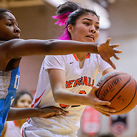 Gallup Bengal Rhiannon Singer (32) pulls a rebound away from Cleveland Storm Jade Hill (10) Saturday at Gallup High School.