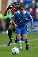 Photo: Chris Brunskill. Wigan Athletic v Ipswich Town. Coca-Cola Championship. 05/03/2005. Leighton Baines of WIgan is pursued by Darren Bent of Ipswich.