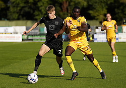 Port Vale Lewis Cass (left) and Sutton United's Enzio Boldewijn battle for the ball during the Sky Bet League Two match at Borough Sports Ground, Sutton. Picture date: Saturday October 9, 2021.