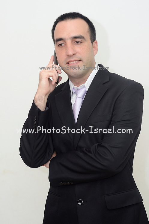 Young businessman in suit and tie on a cell phone