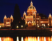 Night view of Parliament Buildings reflected in Inner harbour of Victoria Harbour, Victoria, British Columbia, Canada.