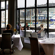 Martin Bosley's Restaurant,  Upstairs at the Royal Port Nicholson Yacht Club,  Oriental Parade, Oriental Bay, Wellington The waterfront location, offers panoramic views of Wellington and its harbour. The award winning restaurant won the 2008 Cuisine Restaurant Of The Year Award. Oriental parade. Wellington, New Zealand.  22nd January 2011.  Photo Tim Clayton..