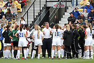 04 December 2011: Duke head coach Robbie Church (center, facing) addresses his team during the second half media timeout. The Stanford University Cardinal defeated the Duke University Blue Devils 1-0 at KSU Soccer Stadium in Kennesaw, Georgia in the NCAA Division I Women's Soccer College Cup Final.