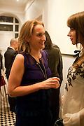 CHRISTINE AL-BADER; CAROLINE SIEBER Party hosted for Jason Wu by Plum Sykes and Christine Al-Bader. Ladbroke Grove. London. 22 March 2011. -DO NOT ARCHIVE-© Copyright Photograph by Dafydd Jones. 248 Clapham Rd. London SW9 0PZ. Tel 0207 820 0771. www.dafjones.com.