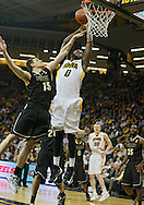 February 27 2013: Iowa Hawkeyes center Gabriel Olaseni (0) is fouled by Purdue Boilermakers forward Donnie Hale (15) during the first half of the NCAA basketball game between the Purdue Boilermakers and the Iowa Hawkeyes at Carver-Hawkeye Arena in Iowa City, Iowa on Wednesday, February 27 2013.