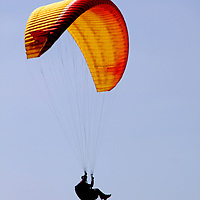 USA, California, San Diego. Paraglider hanging in sky.
