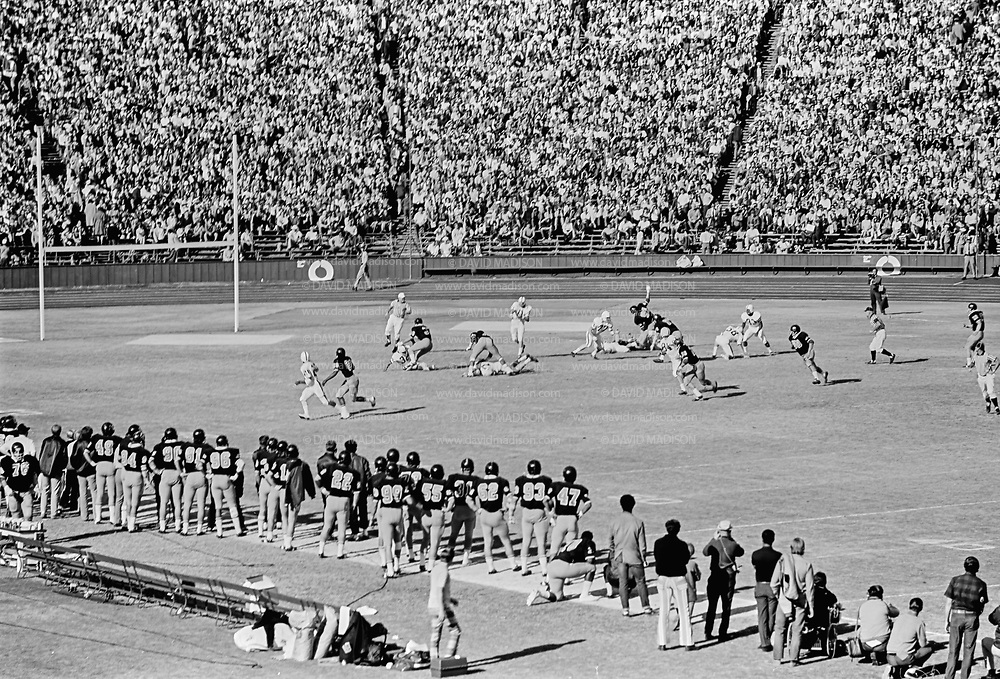 COLLEGE FOOTBALL:  Stanford quarterback Don Bunce #11 throws a pass during the 1971 Big Game against Cal played on November 20, 1971 at Stanford Stadium in Palo Alto, California.  Stanford won by a score of 14-0.  BW R0129-