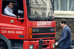 © Licensed to London News Pictures. 01/05/2012. London, UK . Deputy Prime Minister Nick Clegg negotiates around a lorry as he arrives on Downing Street. Cabinet ministers in Downing Street for the Cabinet Meeting on 1st May 2012. Photo credit : Stephen Simpson/LNP