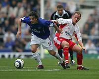 Simon Davies of Everton and Nicky Butt of Birmingham City