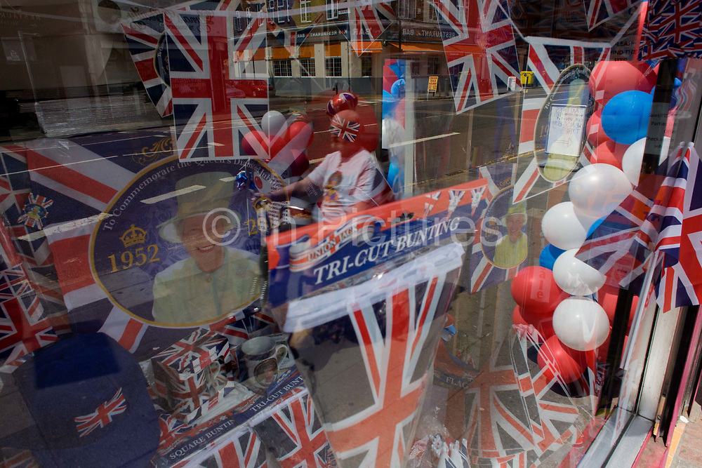 Patriotic bunting, flags, balloons and royal memorabilia on display before the Queen's Golden Jubilee in a south London shop window. A few months before the Olympics come to London, the UK is gearing up for a weekend and summer of pomp and patriotic fervour as their monarch celebrates 60 years on the throne and across Britain, flags and Union Jack bunting adorn towns and villages.