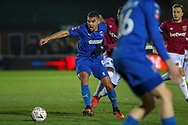 AFC Wimbledon striker Kweshi Appiah (9) battles for possession during the The FA Cup match between AFC Wimbledon and West Ham United at the Cherry Red Records Stadium, Kingston, England on 26 January 2019.