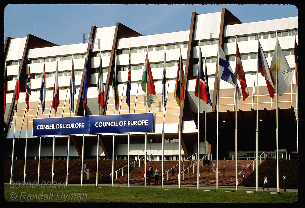 Flags of European nations line front of the modernistic Council of Europe headqrtrs; Strasbourg. France