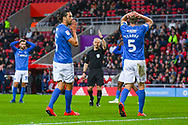 Christian Burgess of Portsmouth (6) reacts during the EFL Sky Bet League 1 first leg Play Off match between Sunderland and Portsmouth at the Stadium Of Light, Sunderland, England on 11 May 2019.