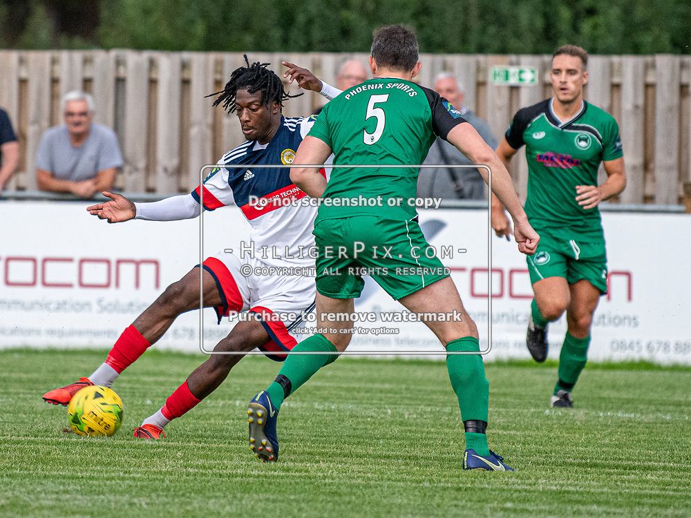 DARTFORD, UK - AUGUST 01: Andre Coker, of Cray Wanderers FC, tries to dribble past the defender during the pre-season friendly match between Phoenix Sports FC and Cray Wanderers FC at The Mayplace Ground on August 1, 2019 in Dartford, UK. <br /> (Photo: Jon Hilliger)