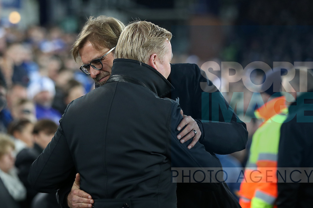 Jurgen Klopp manager of Liverpool and Everton manager Ronald Koeman before the English Premier League match at Goodison Park, Liverpool. Picture date: December 19th, 2016. Photo credit should read: Lynne Cameron/Sportimage