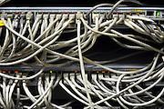 Nederland, Nijmegen, 9-12-2010Datakabels van een computernetwerk komen samen in kast met routerss.Foto: Flip Franssen/Hollandse Hoogte