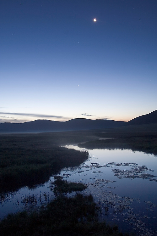 The sun rises over the Jemez River, running through the Valle Grande in Valles Caldera National Preserve, New Mexico on July 21, 2006.