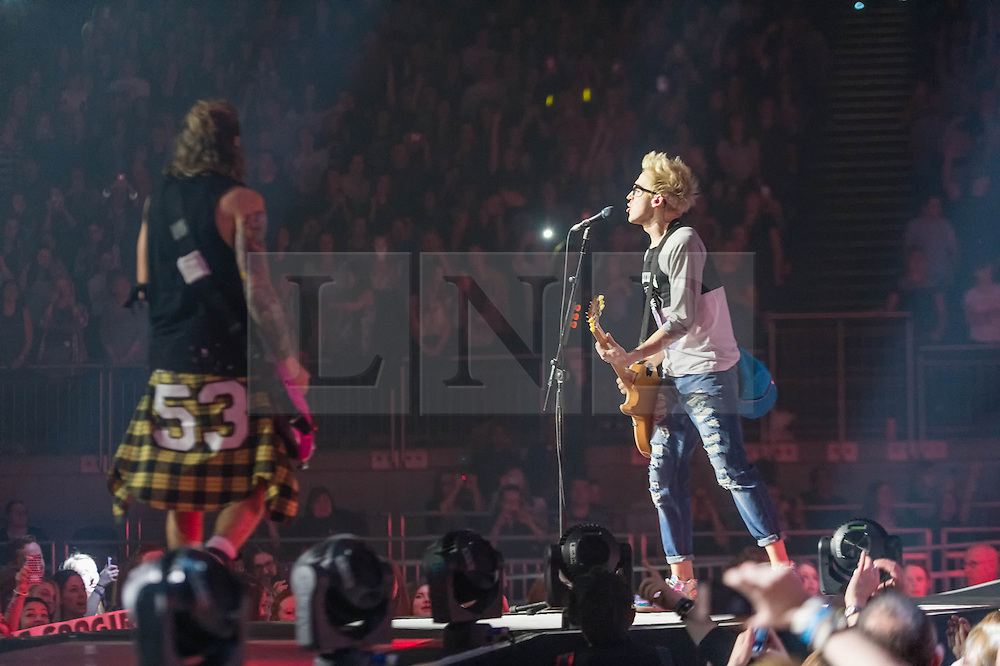 © Licensed to London News Pictures. 24/04/2014. London, UK.   McBusted performing live at The O2 Arena.   In this picture - Dougie Poynter (left), Tom Fletcher (right).   *** LICENSE CONDITIONS USAGE ALLOWED ONLY UNTIL 14 MAY 2014, NO USAGE BEYOND THAT DATE***.   McBusted are an English pop-rock group composed of members of the bands Busted & McFly - James Bourne, Tony Fletcher, Danny Jones, Harry Judd, Dougie Poynter, and Matt Willis.  The only member of the original groups not participating in the new lineup is former Busted singer CharlieSimpson. Photo credit : Richard Isaac/LNP