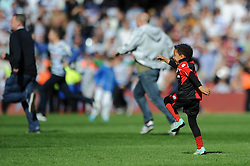 A young QPR fan runs onto the pitch alone during a pitch invasion - Photo mandatory by-line: Dougie Allward/JMP - Mobile: 07966 386802 - 16/05/2015 - SPORT - football - London - Loftus Road - QPR v Newcastle United - Barclays Premier League