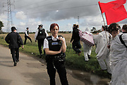 Out numbered police face large numbers of climate activists making their way towards the Coryton oil refinery.<br /> <br /> Crude Oil Awakening is a coalition of climate change activist groups. On Saturday Oct 16 they shut the only entrance to Coryton oil refinery in Essex, UK with the aim of highlighting the issues of climate change and the burning of fossil fuels. The blockade meant that a great number of trucks with oil were not able to leave the refinary during the day of action.