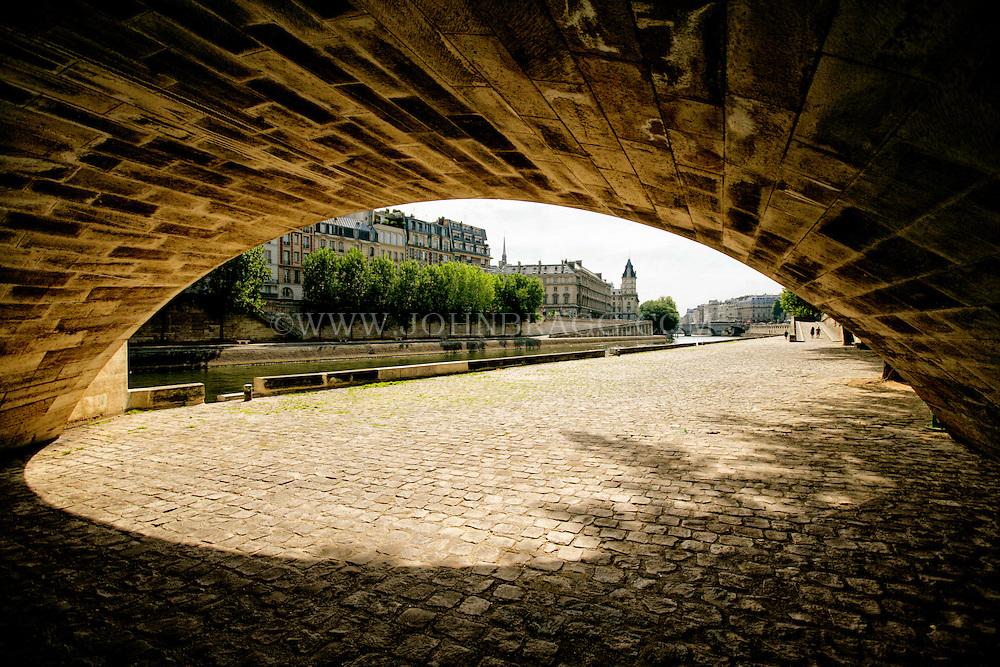 Seine River Walkway beneath a bridge, Paris, France.