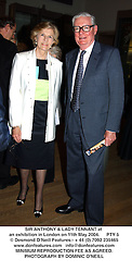 SIR ANTHONY & LADY TENNANT at an exhibition in London on 11th May 2004.PTY 5