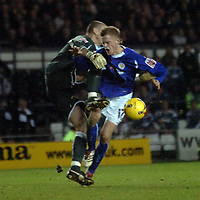 Photo: Kevin Poolman.<br />Derby County v Leicester City. Coca Cola Championship. 25/11/2006. Richard Stearnan of Leicester is taken out by Derby keeper Stephen Bywater.