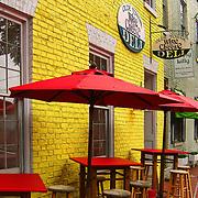 Colorful umbrellas outside a cafe along Caroline Street.