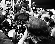 Mohammad Ali carries a shillelagh on his arrival in Ireland in advance of his bout against Al 'Blue' Lewis at Croke Park on 19 July. Ali won the fight with an 11th round knockout in front of a crowd of 25,000 Irish fans.<br />