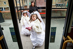 © Licensed to London News Pictures. 12/03/2017. London, UK. Orthodox Jewish children in fancy dress board on a bus whilst celebrating the festival of Purim in the streets of Stamford Hill in north London on Sunday, 12 March 2017. Purim celebrates the miraculous salvation of the Jews from a genocidal plot in ancient Persia, an event documented in the Book of Esther. Traditionally the jewish community wear fancy dress and exchange reciprocal gifts of food and drink. Photo credit: Tolga Akmen/LNP