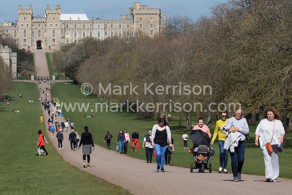 Windsor, UK. 29th March, 2021. Local residents and visitors enjoy a stroll on the Long Walk in Windsor Great Park at the beginning of what is expected to be a short spell of warm weather. The government has from today eased COVID-19 restrictions on outdoor gatherings in public spaces and private gardens by allowing two households of any size or six people from up to six households to meet outside in England.