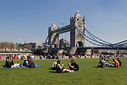 Crowds of office workers and tourists at lunchtime sit on the grass on the South Bank in front of Tower Bridge during hot and sunny weather on April 20, 2018 in London, England. Yesterday the United Kingdom experienced the hottest day in April since 1949, with temperatures reaching 27.9C 82.2F in London.