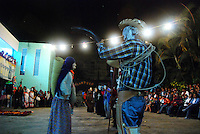 """MEXICO, Veracruz, Tantoyuca, Oct 27- Nov 4, 2009. The """"vaquero"""" cuadrillo character starts off their team's dances at the Preparatorio Benito Juarez in Tantoyuca.""""Xantolo,"""" the Nahuatl word for """"Santos,"""" or holy, marks a week-long period during which the whole Huasteca region of northern Veracruz state prepares for """"Dia de los Muertos,"""" the Day of the Dead. For children on the nights of October 31st and adults on November 1st, there is costumed dancing in the streets, and a carnival atmosphere, while Mexican families also honor the yearly return of the souls of their relatives at home and in the graveyards, with flower-bedecked altars and the foods their loved ones preferred in life. Photographs for HOY by Jay Dunn."""