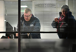 © Licensed to London News Pictures. 23/03/2018. London, UK. Enforcement Officers from the Information Commissioner's Office (ICO) are seen inside the London headquarters of data firm Cambridge Analytica. The ICO have just been granted a warrant to allow them to search the office. Cambridge Analytica has been implicated in an investigation into the misuse of Facebook user data to influence the outcome of elections. Photo credit: Ben Cawthra/LNP