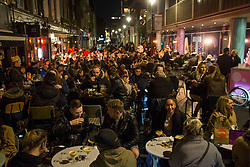 © Licensed to London News Pictures.  16/04/2021. London, UK. Members of the public make the most of Friday night in Soho, Central London. Earlier this week Lockdown restrictions were eased to allow non essential retail and outdoor dining to reopen. Photo credit: Marcin Nowak/LNP