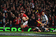 Leigh Halfpenny of Wales on his way to scoring his 1st try. RBS Six nations championship 2012, Wales v Scotland at the Millennium Stadium in Cardiff on Sunday 12th Feb 2012.  pic by Andrew Orchard, Andrew Orchard sports photography,