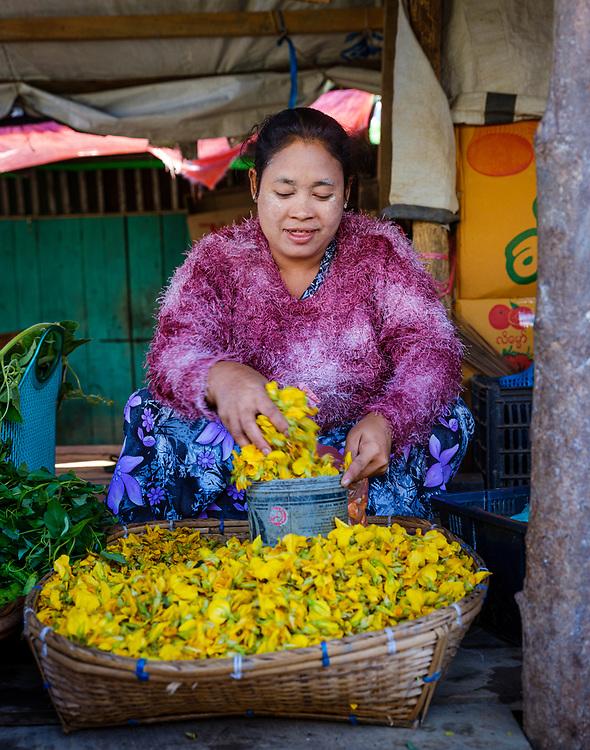 MRAUK U, MYANMAR - CIRCA DECEMBER 2017: Portrait of a burmese woman in the Mrauk U market.