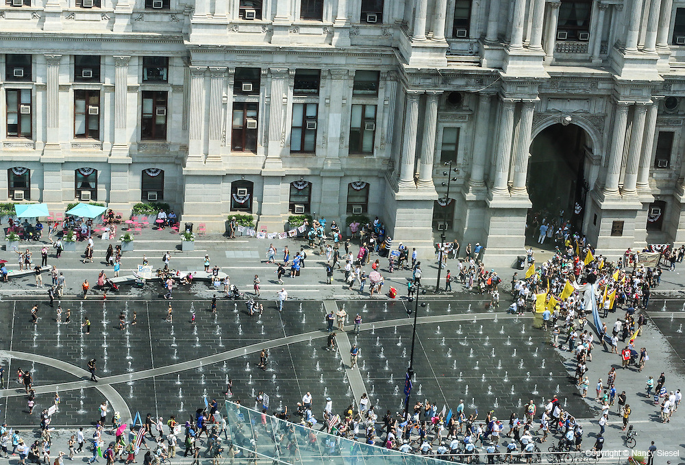 Overview of protesters gathering in front of City Hall n Philadelphia PA,for a march in opposition to the DNC, and the Democratic nominee for president Hillary Clinton.