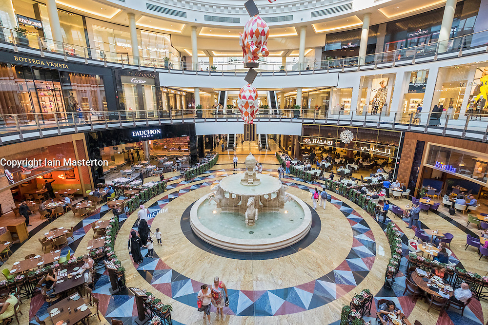 Interior of atrium with food courts and high end fashion boutiques at Mall of the Emirates in Dubai United Arab Emirates