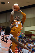 FORT WORTH, TX - JANUARY 19: Jonathan Holmes #10 of the Texas Longhorns drives to the basket against the TCU Horned Frogs on January 19, 2015 at Wilkerson-Greines AC in Fort Worth, Texas.  (Photo by Cooper Neill/Getty Images) *** Local Caption *** Jonathan Holmes