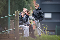 © Licensed to London News Pictures . 20/09/2014 . Manchester , UK . Youths watch from across the road . Arrivals at the funeral of Heywood and Middleton MP Jim Dobbin at Salford Cathedral today (Saturday 20th September 2014) . Photo credit : Joel Goodman/LNP