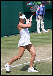 July 6, 2017 - London, London, United Kingdom - Image licensed to i-Images Picture Agency. 06/07/2017. London, United Kingdom. Four-and-a-half months pregnant tennis player  Mandy Minella  in action in her ladies doubles match on day four of the Wimbledon Tennis Championships in London. Picture by Stephen Lock / i-Images (Credit Image: © Stephen Lock/i-Images via ZUMA Press)