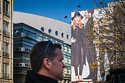 Fashion billboard at the Kouter showing a red hair woman in black clothes, ghent, Belgium, 01.11.2015