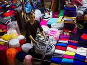 "22 DECEMBER 2017 - HANOI, VIETNAM: A shop in the wholesale clothes and fabric section of Dong Xuan Market in the old quarter of Hanoi. The old quarter is the heart of Hanoi, with narrow streets and lots of small shops but it's being ""gentrified"" because of tourism and some of the shops are being turned into hotels and cafes for tourists and wealthy Vietnamese.    PHOTO BY JACK KURTZ"
