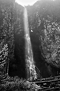 Limited Edition: <br /> Fairy Falls - middle geyser area with tall and long waterfall that ends in a small dark pool. Black & White