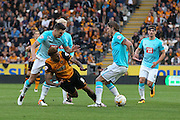 Derby County defender Jason Shackell (14)  fouls Hull City striker Abel Hernandez (9)  during the Sky Bet Championship play-off 2nd leg match between Hull City and Derby County at the KC Stadium, Kingston upon Hull, England on 17 May 2016. Photo by Simon Davies.