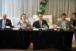 (From L to R) France's former foreign minister Laurent Fabius, French Housing Minister Emmanuelle Cosse, French President Francois Hollande and French environmentalist Nicolas Hulot and Permanent Representative of France To the United Nations Jean-David Levitte, attend a work session with NGO's on the sidelines of the COP22 Climate Change Conference in Marrakesh, Morocco, on November 16, 2016. Photo Alain Robert/ABACAPRESS.COM