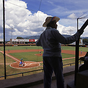 A man looks for a seat at the beginning of a baseball game between the Saltillo, Saraperos and the Oaxaca Charros at the baseball stadium in Oaxaca, Mexico in June, 1996. The Mexican Baseball league, once a league for castoffs and has-beens from Major League Baseball in America, has gained respect the last several years after producing a number of Major League All-Stars such as Vinny Castilla who played in Oaxaca.