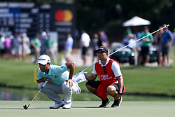 September 22, 2017 - Atlanta, Georgia, United States - Xander Schauffele (L) and his caddie Austin Kaiser line up a putt on the 15th green during the second round of the TOUR Championship at the East Lake Club. (Credit Image: © Debby Wong via ZUMA Wire)
